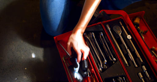 Woman arranging tools in tool box 4k Footage