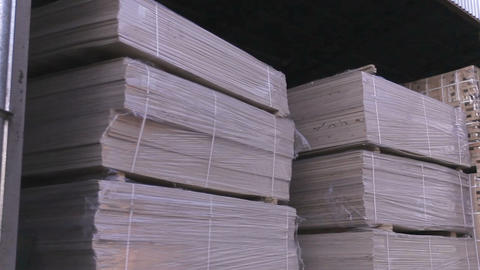 Plywood is stored in the warehouse. Warehouse of the furniture factory Footage