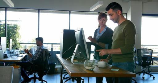Executives discussing over desktop pc at desk 4k Live Action