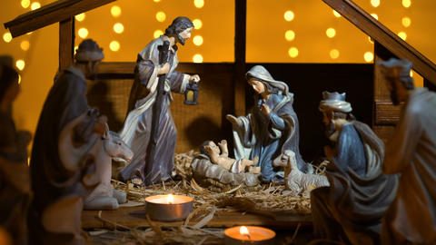 Jesus Christ Nativity scene with atmospheric lights and candles Footage