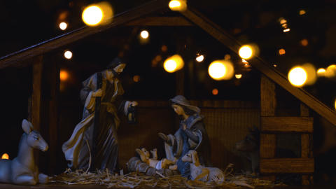 Jesus Christ Nativity scene with atmospheric lights and candles GIF