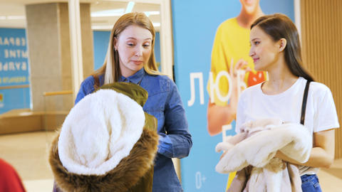 young women buy natural fur coats in expensive fashion store Footage