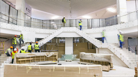 skilled workers install handrails on mall stairs timelapse Footage