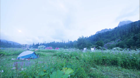 Tourist people in summer camping in mountain landscape timelapse Live Action