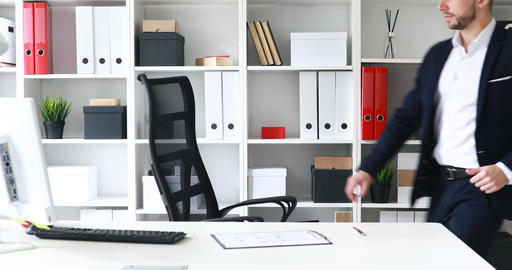 Young adult businessman coming in workplace in modern office Footage