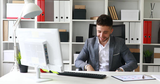 businessman in workplace rejoicing and spinning on chair Live Action