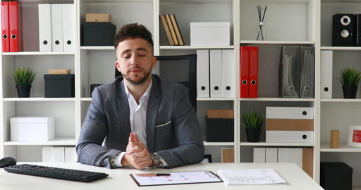 young adult businessman in workplace looking at camera in modern office ビデオ