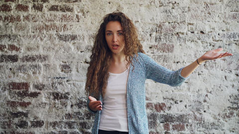 Portrait of angry young woman talking and gesturing expressing negative emotions Footage