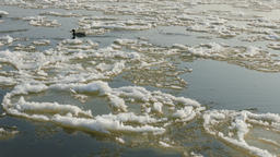 Ice floe is drifting quickly on a river. Spring thaw Footage