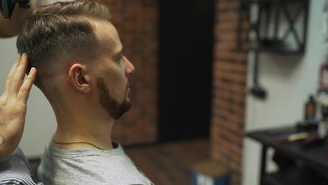 Men's hairstyling, haircutting, in a barber shop or hair salon. Men's Footage