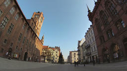 Torun city, old town. Unesco heritage site in Poland. Town Hall on the left Live Action