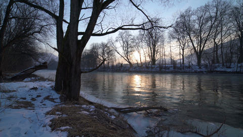 Winter sunrise on river bank ビデオ