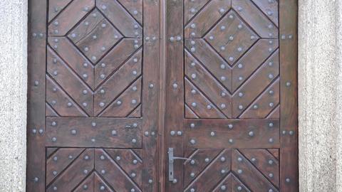 Old wooden entrance door. Wooden door with ancient patten. Ancient wooden door Live Action