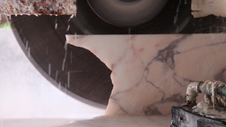 saw blade sawing marble stone block Footage