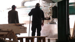 workers waiting for industrial saw to cut block of marble stone, slider shot Footage