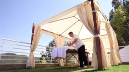 tent with the person receiving relaxing massage, slider shot Footage