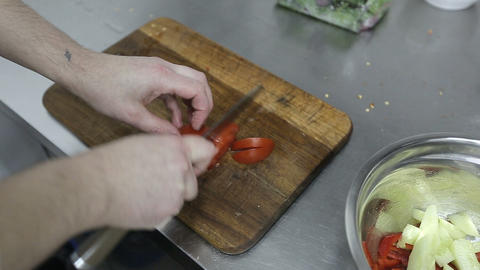 Chef chopping vegetables. Close-up of chef hands cooking and preparing food in r Footage