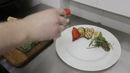 Chef prepares a steak dish in a restaurant kitchen. Close up, dish presentation Live Action