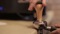 Bartender grinding coffee for espresso in restaurant. closeup Footage