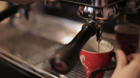 The bartender makes coffee with professional machine. closeup Footage