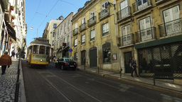 historic 100 years old yellow tram old street in Lisbon steady cam gimbal Footage