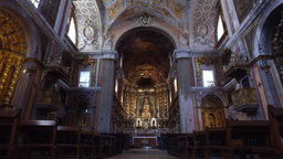 hall and altarpiece of gilded Church of St. Catherine in Lisbon, steady cam Archivo