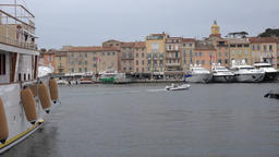 France Cote d'Azur Saint Tropez old ship with fender and cityscape from harbor Footage