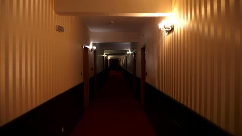 POV footage walking in poorly lit hotel hall Footage