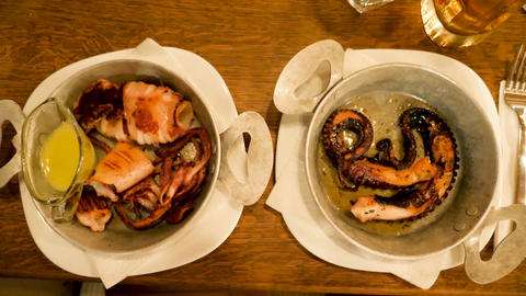 Zoom in footage on two plates with gourmet seafood Live Action