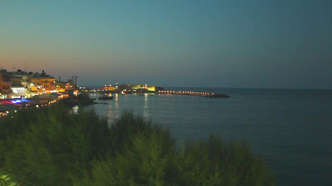 Bright lights of hotels and summer cafes along the beautiful seashore. Beautiful Footage