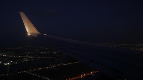 airplane wing. flying at night over city light and street Footage