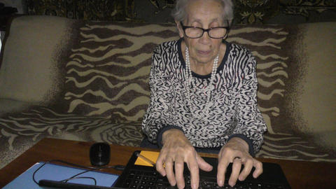An elderly woman and a computer Footage