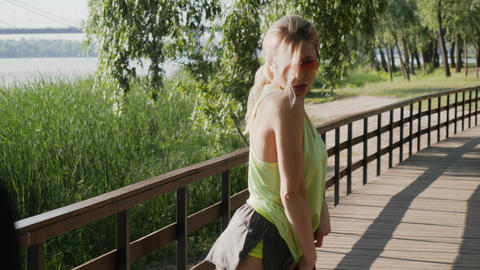 Beautiful young blonde posing outdoors Footage