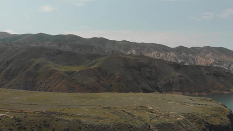 Panning shot of mountain ridge and water surface of lake in Armenian Highlands Footage