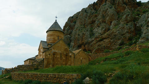 Old Surb Karapet Church of Noravank monastery at the foot of red rock in Footage