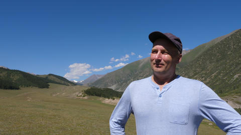 Portrait adult man standing on mountain landscape and... Stock Video Footage