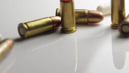 Close up of a barrel of a gun with bullet casings. Live rounds of shell casings Footage
