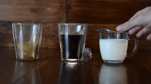 three ingredients for coffee with ice are spread out over cups 영상물