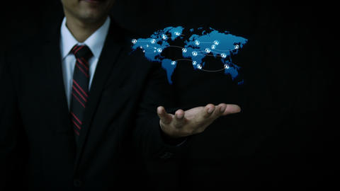 Business man using hologram world map and connecting people GIF