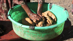 Woman washing clothes with hands GIF