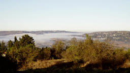 Early morning mist flow along the valleys Footage