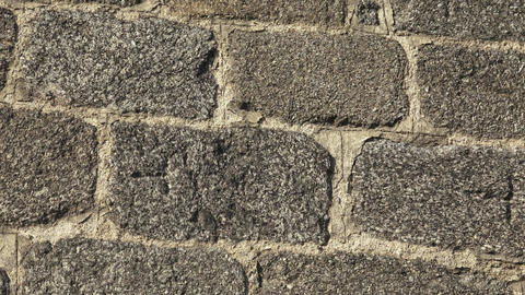 Texture of a stone wall. Old castle stone wall texture background. Stone wall as Footage