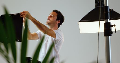 Male photographer adjusting strobe light 4k Footage