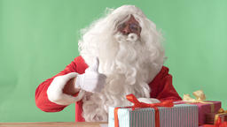 Santa Claus showing like sign and smiling, chromakey in background Footage