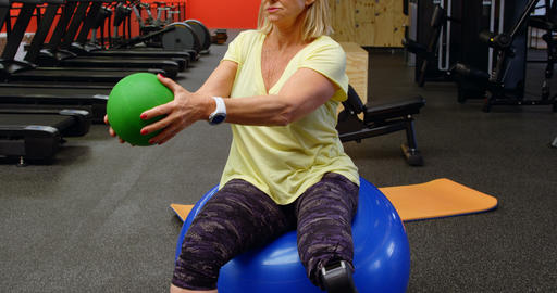 Senior woman doing abs workout with exercise ball 4k Footage