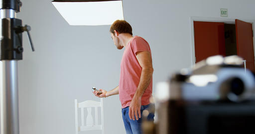 Male photographer holding voice recorder 4k Footage