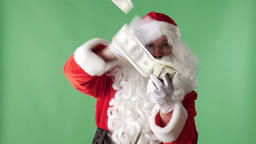 Satisfied Santa Claus throwing bills out of a bundle money in camera, money Footage