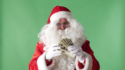 Satisfied Santa Claus throwing bills out of a bundle money rain, concept, green Footage