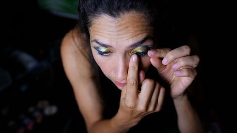 Female video blogger applying eyelash 4k Live Action