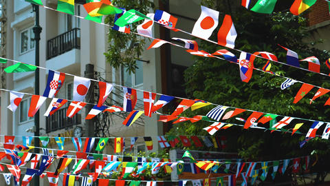 flags of various states on the streets of the city Live Action